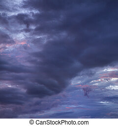 Maui storm clouds. - Dark ominous storm clouds spreading...