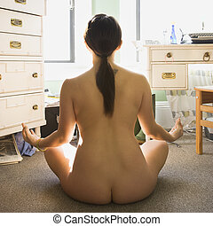 Nude woman meditating. - Back view of pretty nude Asian...