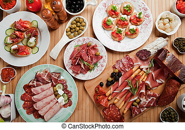 Antipasto food - Prosciutto di Parma, various canape snacks...