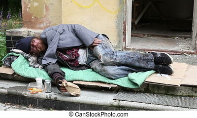 In the open air - Homeless man sleeping in the open air on...
