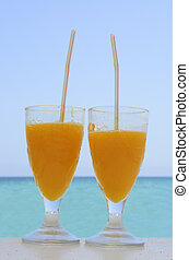Two glasses with orange juice