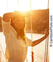 Beautiful woman on yacht on sunset - Portrait of beautiful...