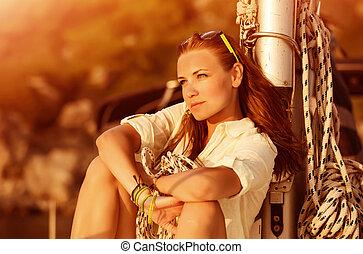 Beautiful woman on sunset