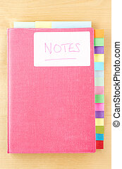 Notebook with Blank Tab Dividers - Pink notebook on a light...