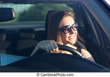 Beautiful businesswoman driving the car - Beautiful...