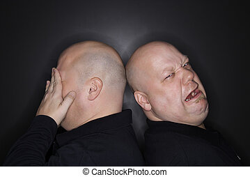 Twin brothers crying - Caucasian bald mid adult identical...