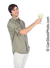Happy young man with wine glass of white wine