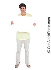 Smiling man holding empty sign