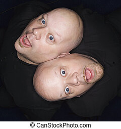 Twin bald men. - Aeriel view of Caucasian bald identical...