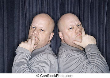Identical twin men - Caucasian bald identical twin men...