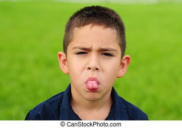 Child sticking out tongue - Naughty young child sticking out...