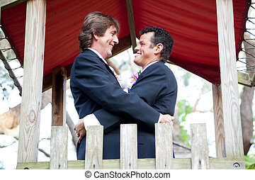 Happy Gay Couple Marries in the Park - Happy gay couple...