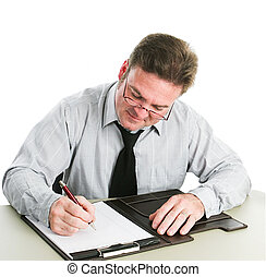 Businessman Writing on Legal Pad - Businessman looking down...