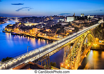 Porto with the Dom Luiz bridge - Night view of the historic...