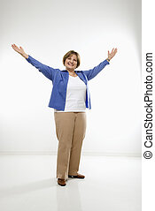 Woman with open arms. - Caucasian middle aged woman standing...