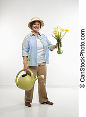 Woman gardening - Caucasian middle aged woman holding...