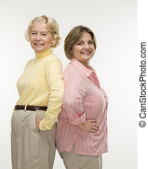 Two women. - Caucasian senior woman and middle aged woman...