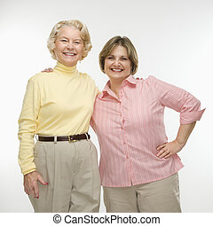 Women friends - Caucasian senior woman and middle aged woman...