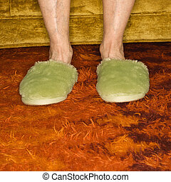 Feet wearing slippers. - Caucasian senior female feet...
