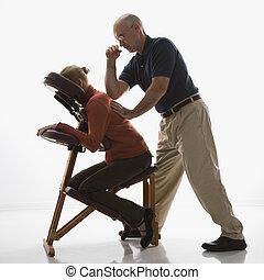 Man massaging woman. - Caucasian middle-aged male massage...