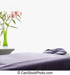 Massage table. - Spa scene of massage table with purple...
