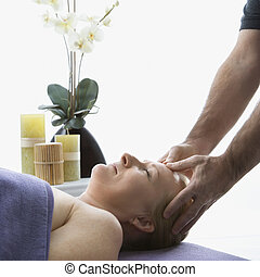 Man massaging woman - Caucasian middle-aged male massage...