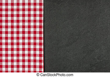 Slate plate with a red checkered tablecloth