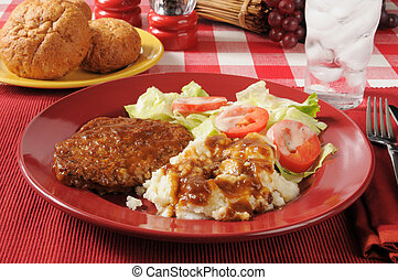 Meatloaf and mashed potatoes - A plate of meatloaf with...