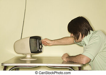 Man with retro television. - Side view of Caucasian...