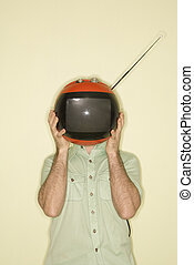 TV over man's head. - Caucasian mid-adult man holding round...