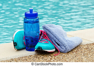 Exercise and hydration concept - Blue water bottle with...