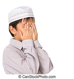Muslim boys - Islamic pray explanation Asian child showing...