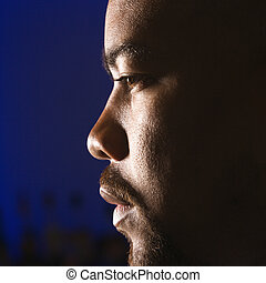 Portrait of man - Close up profile of African American man...