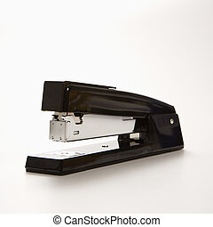 Stapler - Black stapler on white background