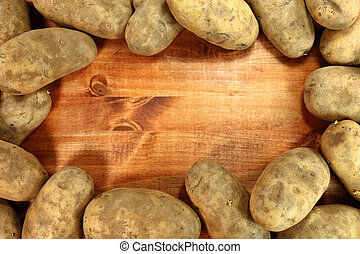 Russet Potatoes on a Wooden Background
