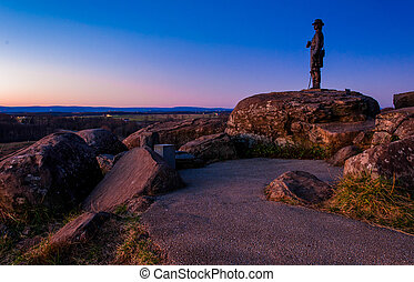 Boulders and statue on Little Round Top at twilight,...