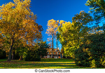 Mansion and autumn colors in Longwood Gardens, Pennsylvania....