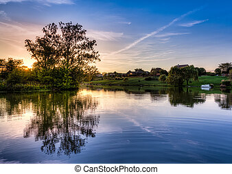 Sunset on the lake - Peaceful sunset scene on a small lake...