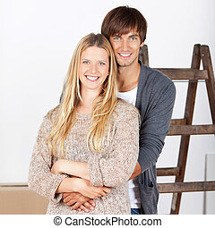 happy young couple renovating their home - happy young...