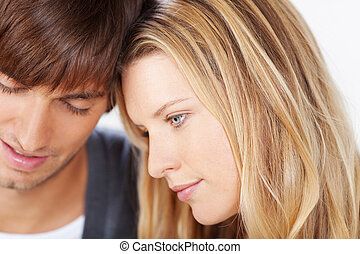 romantic couple - young woman leaning her head on her...
