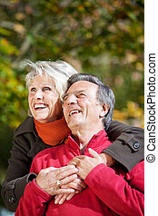 Cheerful senior couple - Portrait of senior woman embracing...