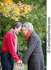 Romantic mature couple - Romantic senior couple looking at...
