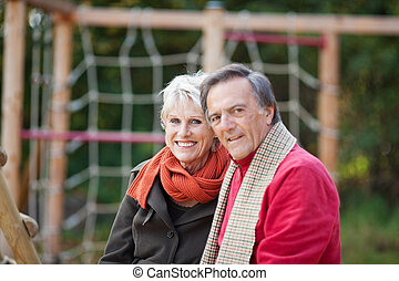 Senior Couple spending time on the playground - A happy...