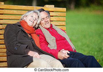 Senior couple relaxing in the park - Senior couple enjoying...