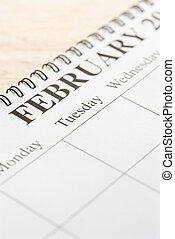 February on calendar - Close up of spiral bound calendar...