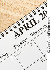 April on calendar - Close up of spiral bound calendar...