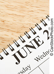 June on calendar. - Close up of spiral bound calendar...