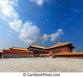 the imperial palace against a blue sky in beijing