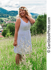 summer - Young blond plus-size model in the white linen...
