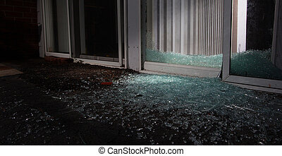 Shattered window - Nighttime entry point to a house for a...